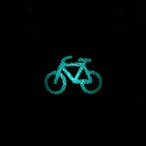 Bicycle sign in the city by night Stock Images