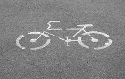 Bicycle sign on concrete pathway street Stock Photography