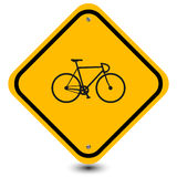 Bicycle sign. Illustration of a black bicycle on a yellow sign board with a black (internal) border used in Australia, United States and Ireland to indicate a stock illustration