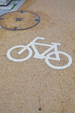 Bicycle sign. Bicycle lane with white bicycle sign Stock Photo