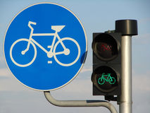 Bicycle sign and light. Bicycle sign and green light royalty free stock photography