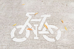 Bicycle sign painted on the bike lane in the park Royalty Free Stock Images