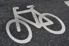 Bicycle sign on the road Stock Photos