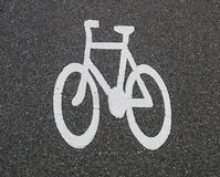 Bicycle sign on the road Royalty Free Stock Photo