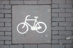Bicycle sign way. A bicycle sign from a bicycle path, painted with white on grey Royalty Free Stock Images