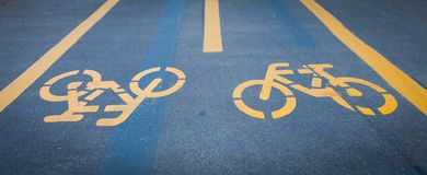 Bicycle signs painted on asphalt Royalty Free Stock Photos