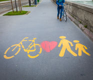 Bicycle signs painted on asphalt Royalty Free Stock Images