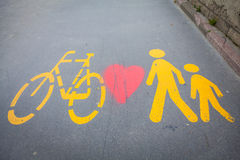 Bicycle signs painted on asphalt Stock Images