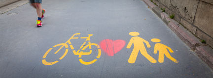 Bicycle signs painted on asphalt Stock Photos
