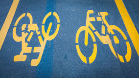 Bicycle signs painted on asphalt Stock Photo