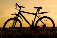 Bicycle silhouette. And summer sunset stock photos