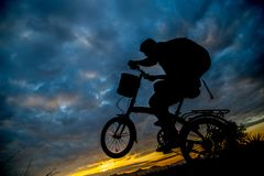 Bicycle silhouette lifestyle. In the morning stock photography
