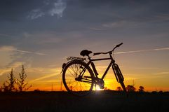 Bicycle silhouette on sunset. Bicycle silhouette - retro bike with sunset sky in background. Healthy recreation and activity stock images