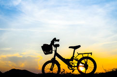 Bicycle silhouette with sun set. Bicycle silhouette with sun set wih wooden board Stock Images