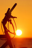 Bicycle silhouette at the sunse. T near sea royalty free stock photography
