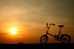 Bicycle silhouette at sunset. Beauty bicycle silhouette against colorful sunset Royalty Free Stock Photo