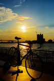 Bicycle silhouette sunset. In Bangkok and Chopraya river, Thailand stock photo