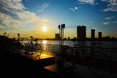 Bicycle silhouette sunset. In Bangkok and Chopraya river, Thailand stock images