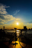 Bicycle silhouette sunset. In Bangkok and Chopraya river, Thailand stock photos