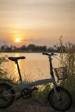 Bicycle Silhouette sunset. On river Royalty Free Stock Photos