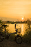 Bicycle Silhouette sunset. On river Royalty Free Stock Photography