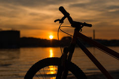 Bicycle silhouette on a sunset. Summer landscape. One bicycle silhouette on a sunset. Summer landscape Royalty Free Stock Images
