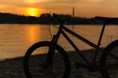 Bicycle silhouette on a sunset. Summer landscape. One bicycle silhouette on a sunset. Summer landscape Stock Photo