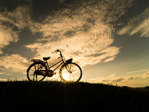Bicycle silhouette. At the sunset or sunrise stock photos