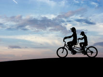 Bicycle sky N1. People's silhouette with the sky in the bottom Royalty Free Stock Image