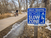 Bicycle slow zone sign on Poudre Trail Stock Photos