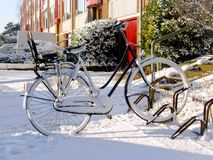 Bicycle in snow in Holland Stock Photos