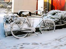Bicycle in snow in Holland Stock Photography
