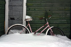 Bicycle in Snow by old shed royalty free stock photos