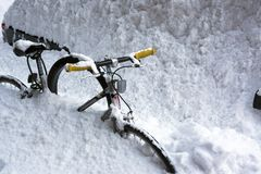 Bicycle in snow storm Stock Photo
