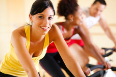 Bicycle Spinning in gym Stock Images
