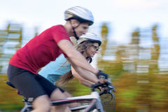 Bicycle and Sport Concepts: Young Caucasian Couple Having a Sppe Stock Photography