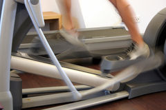 Bicycle In Sport Studio. Bicycle in a sport studio with an sportsman royalty free stock image