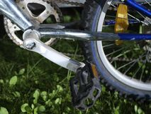 Bicycle sprocket and pedal. Bicycle sprocket, pedal and wheel, outdoor cropped image royalty free stock image
