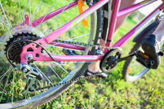 Bicycle sprocket on the rear wheel of the cycle. Bicycle sprocket on the rear wheel of the bicycle and feet on the pedals Stock Photos