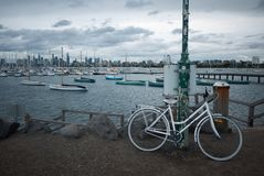 Bicycle at St Kilda Pier. White bicycle at St Kilda Pier on cloudy weather in Melbourne Stock Image