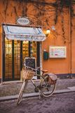 bicycle standing in front of sweets store on street of Rome royalty free stock photos