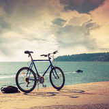 Bicycle stands on concrete pier, Black Sea coast Royalty Free Stock Photo