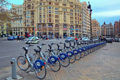 Bicycle station on city square. Royalty Free Stock Photo
