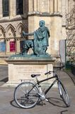 A bicycle at statue of Constantine The Great situated outside York Minster, England, UK royalty free stock image