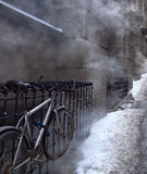 Bicycle and steam Royalty Free Stock Images