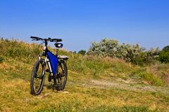 Bicycle in a steppe. Touristic bicycle in a steppe stock photos