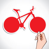 Bicycle sticker in hand Royalty Free Stock Image