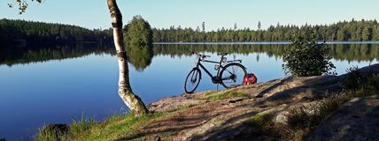 A bicycle on a still beautiful lake
