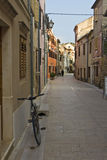 A bicycle in the stone-paved street in Skradin Stock Photo