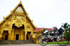 Bicycle stop at front of Wat Sri Pan Ton in Nan, Thailand Royalty Free Stock Images